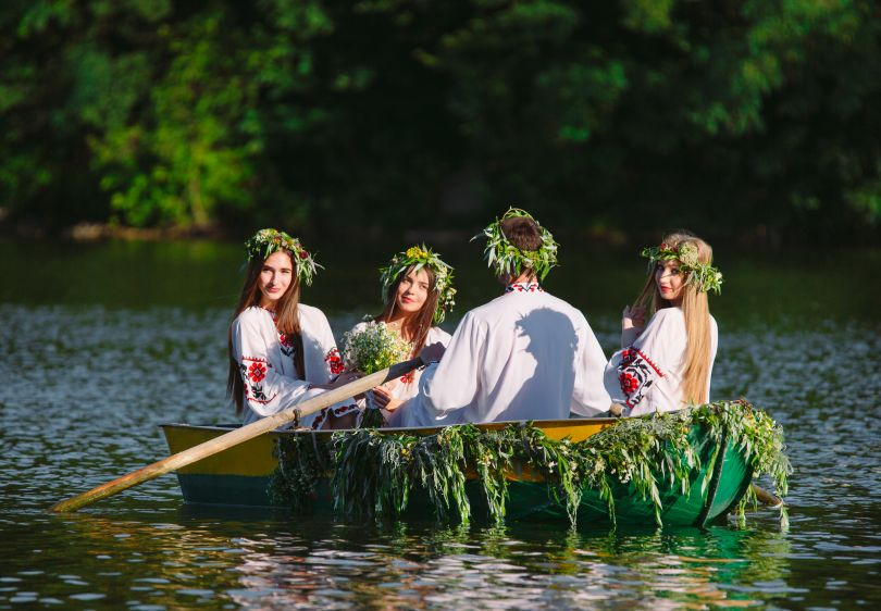 Ukrainians in a boat on Ivana Kupala